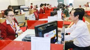 Nhiều ngân hàng thương mại giảm lãi suất tiền gửi VND